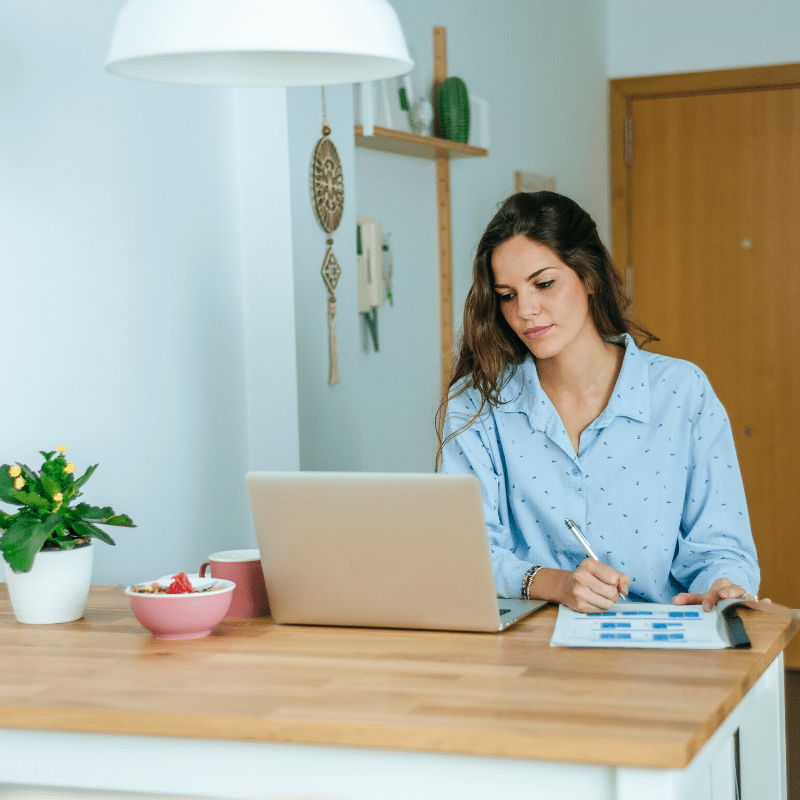 Young woman working at laptop from home