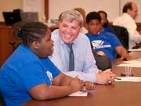A QBE employee provides career advice to a youth during a service project with Boys & Girls Clubs of America.