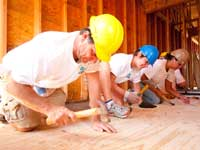 QBE employees donate their time to help build a house with Habitat for Humanity.